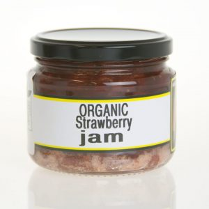 A squat jar of organic strawberry jam