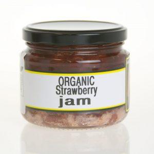 A squat jar of organic strawberry jam