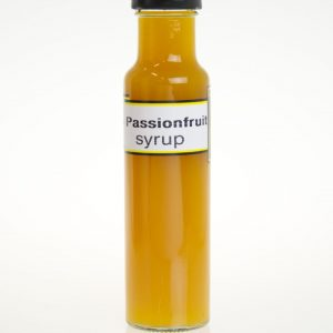A tall bottle of yellow passion fruit syrup.