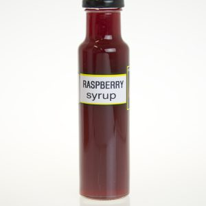 A tall bottle of raspberry syrup