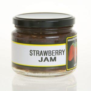 A short wide jar of strawberry jam.