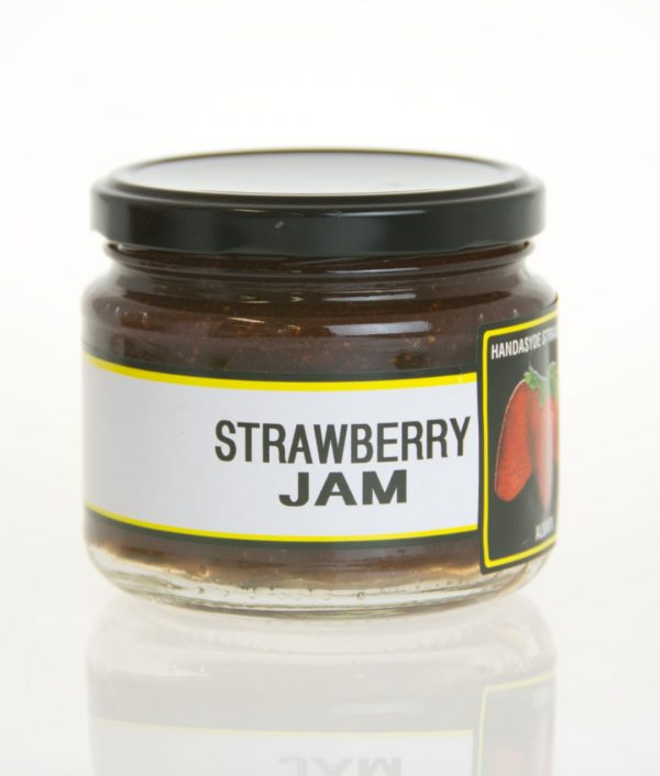 A short wide jar of strawberry jam.