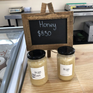 Two jars of bush honey on the counter of the cafe